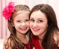 Smiling young woman and her little girl Stock Images