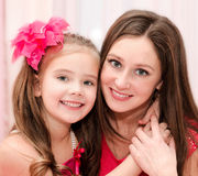 Smiling young woman and her little girl Royalty Free Stock Photography