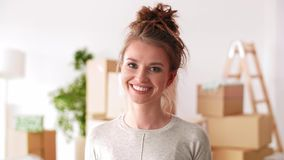 Smiling, young woman in her new apartment. Portrait of smiling, young woman in her new apartment stock footage