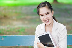 Smiling young woman with her tablet Royalty Free Stock Photo