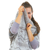 Smiling young woman hiding in sweater neckline Stock Photography