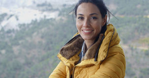 Smiling young woman hiking in the mountains Stock Photo