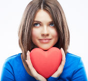 Smiling young woman hold red heart, Valentine day symbol. Girl Stock Image
