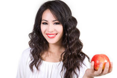 Smiling Young Woman Holding Apple Stock Images