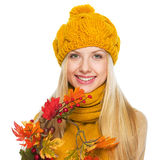 Smiling young woman holding autumn bouquet Royalty Free Stock Photo