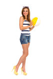 Smiling young woman holding a beach ball. Stock Photo