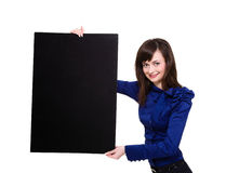 Smiling young woman holding a blank board Stock Photo