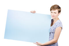 Smiling young woman holding a blank placard Stock Image