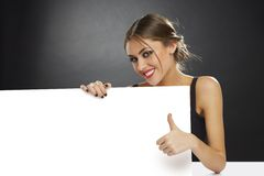 Thumb up and blank billboard Royalty Free Stock Photography