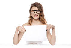 Smiling young woman holding blank white sign Royalty Free Stock Images
