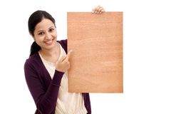 Smiling young Woman holding blank wood sheet Royalty Free Stock Photo