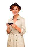 Smiling Young Woman Holding Cell Phone on White Royalty Free Stock Images