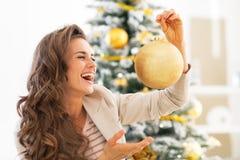 Smiling young woman holding christmas ball Stock Image