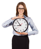 Smiling young woman holding a clock Royalty Free Stock Photography