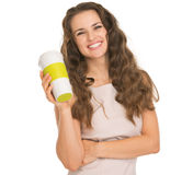 Smiling young woman holding coffee cup Stock Image