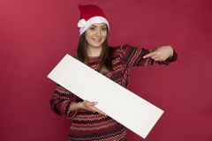 Smiling young woman holding copy space for Christmas sales Stock Photography