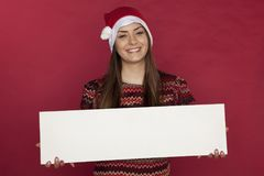 Smiling young woman holding copy space for Christmas sales Stock Image