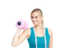 Smiling young woman holding a dumbbell Stock Photos