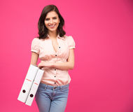 Smiling young woman holding folders Stock Photography
