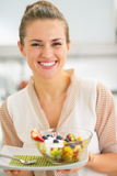 Smiling young woman holding fresh fruit salad Royalty Free Stock Photo