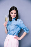 Smiling young woman holding glass of champagne Royalty Free Stock Photo