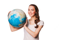 Smiling young woman holding a globe in his hands Stock Image