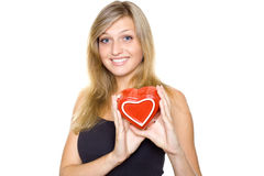 Smiling Young Woman Holding a Heart Royalty Free Stock Images