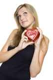 Smiling Young Woman Holding a Heart Stock Photos
