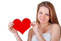 Smiling young woman holding a heart Stock Image