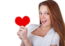Smiling young woman holding a heart Royalty Free Stock Photography