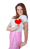 Smiling young woman holding a heart Stock Photo