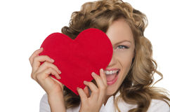 Smiling young woman holding heart in front of eye Stock Images