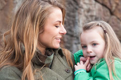 Smiling young woman holding her daughter Royalty Free Stock Image