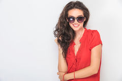 Smiling young woman holding her hand in the elbow Royalty Free Stock Image