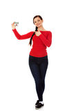 Smiling young woman holding house model Royalty Free Stock Images