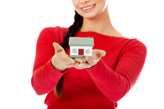 Smiling young woman holding house model Stock Photography