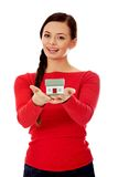 Smiling young woman holding house model Royalty Free Stock Photography