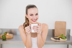 Smiling young woman holding mug Royalty Free Stock Photo