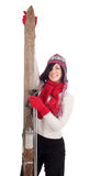 Smiling young woman holding old wooden ski Royalty Free Stock Photos