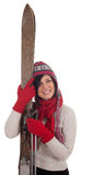 Smiling young woman holding old wooden ski Royalty Free Stock Photography