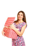 Smiling young woman holding and opening a laundry basket on whit Royalty Free Stock Photography