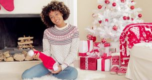 Smiling young woman holding a Santa hat stock footage