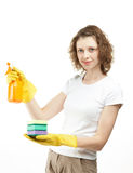 Smiling young woman holding sponge and sprayer Stock Photography