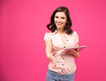 Smiling young woman holding tablet computer Stock Photos