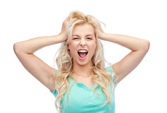 Smiling young woman holding to her head or hair Royalty Free Stock Photos