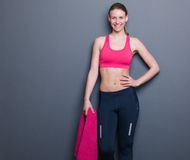 Smiling young woman holding towel Royalty Free Stock Images