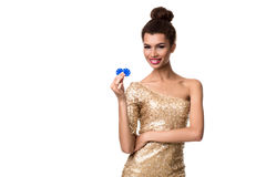 Smiling young woman holding two chips in her hands Stock Images