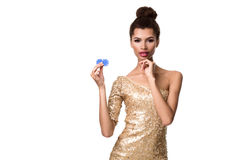 Smiling young woman holding two chips in her hands Stock Photo
