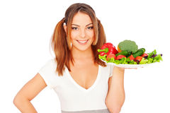 Smiling young woman holding vegetables Stock Images