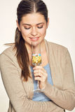 Smiling young woman holding vitamin cocktail in glass. Stock Photos